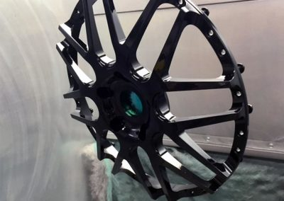 powdercoating-wheel-hanging-in-booth